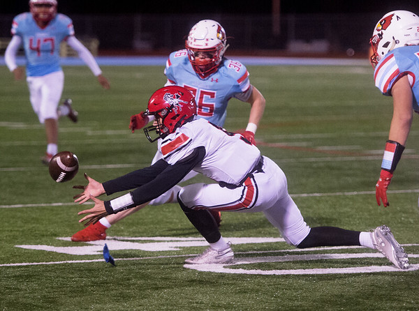 McDonald County's Colton Ruddick recovers a McDonald County fumble on a kick off during Friday's game in Webb City.<br /> Globe | Roger Nomer