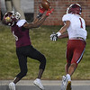 Joplin's Zach Westmoreland (1) and deSmet's Jakailin Johnson (6) vie for a pass during their Class 6 Championship game on Saturday in Columbia.<br /> Globe | Laurie Sisk