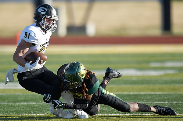 Missouri Southern's Dylan Bolden (27) brings down Emporia State receiver Dexton Swinehart (81) during their game on Saturday at Fred G. Hughes Stadium. <br /> Globe | Laurie Sisk27