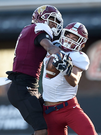 Joplin receiver Zach Westmoreland, right and DeSmet defensive back Jordan Johnson battlw for a pass during their Class 6 Championship game on Saturday in Columbia.. Westmoreland was able to win the battle for a long gain.<br /> Globe   Laurie Sisk