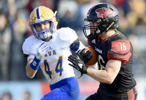 Lamar runningback Case Tucker (16) tries to get past Ava's Spencer Skyles (44) during their playoff game on Saturday at Lamar. <br /> Globe | Laurie Sisk