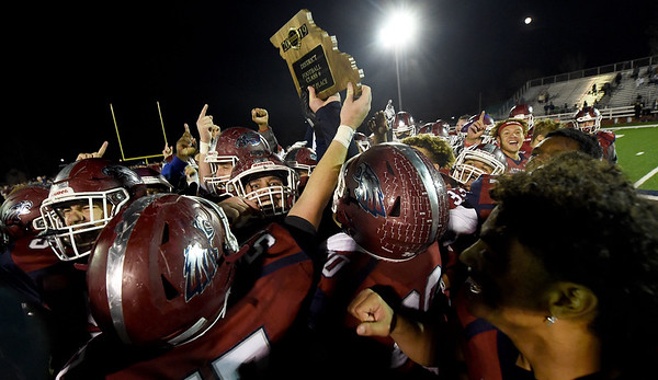 Joplin players hoist the trophy after the Eagles claimed back to back District championships on Friday night at Junge Field.<br /> Globe| Laurie Sisk