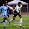 Webb City's Ignatius Mathenge (2) and Neosho's Yahir Ruiz Medellin (10) race for the ball during their Class 3 District 12 championship game on Wednesday night at Carl Junction.<br /> Globe | Laurie Sisk