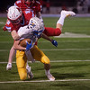 Webb City's Ruben Lenker tackles Boliver's Blade Hancock during Friday's game in Webb City.<br /> Globe | Roger Nomer
