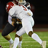 Joplin's Scott Lowe (18) tries to stop Kirkwood's Gerald Jackson (3) during their playoff game on Friday night at Junge Stadium.<br /> Globe | Laurie Sisk