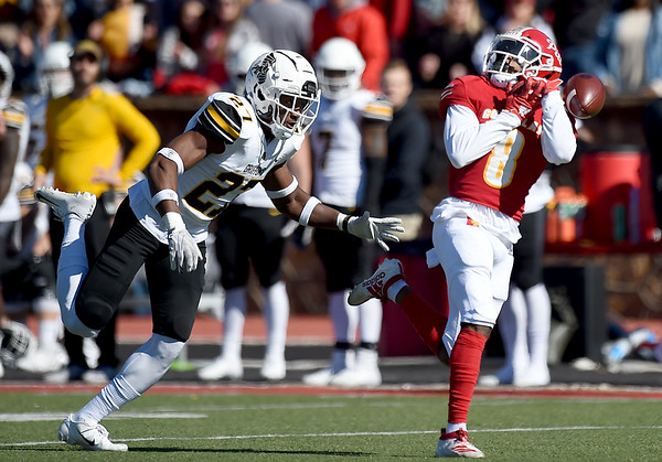 Pittsburg State receiver Lorenzon West (8) can't find the handle on a long pass as Missouri Western's Sam Webb (27) defends during their game on Saturday at PSU.<br /> Globe | Laurie Sisk