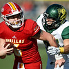Pittsburg State quarterback Mak Sexton (5) tries to elude Missouri Southern's Colton Winder (31) during their game on Saturday at Carnie Smith Stadium.<br /> Globe | Laurie SIsk