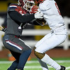 Joplin's James Mataou (14) works to bring down Kirkwood's Will Lee (8) during their playoff game on Friday night at Junge Stadium.<br /> Globe | Laurie Sisk