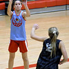 Webb City's Raven Vaughn shoots over Carl junction's Shila Winder (12) during their scrimmage last night at Webb City.<br /> Globe | Laurie SIsk