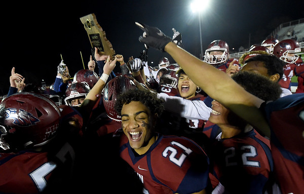 Joplin players hoist the trophy after the Eagles claimed back to back District championships on Friday night at Junge Field.<br /> Globe  Laurie Sisk