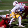 Webb City's Brentan Wilson (7) and Cade Wilson (8) tackle Boliver's Dylan Hall during Friday's game in Webb City.<br /> Globe | Roger Nomer