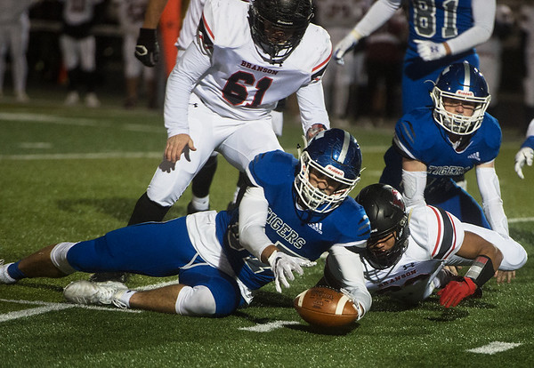 Carthage's Alex Martini secures a Branson fumble during Friday's game in Carthage.<br /> Globe   Roger Nomer