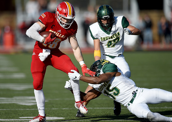 Pittsburg State's Brenner Clemons (18) breaks the grasp of Missouri Southern's John Ejizu (15) as Logan Vander Velden (47) closes in during their game on Saturday at Carnie Smith Stadium.<br /> Globe   Laurie Sisk