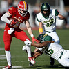 Pittsburg State's Brenner Clemons (18) breaks the grasp of Missouri Southern's John Ejizu (15) as Logan Vander Velden (47) closes in during their game on Saturday at Carnie Smith Stadium.<br /> Globe | Laurie Sisk