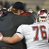 Joplin coach Curtis Jasper and senior Logan Myers embrace after thwir  Class 6 Championship game on Saturday in Columbia.<br /> Globe | Laurie Sisk