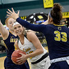 Missouri Southern's Brooke Stauffer (13) splits Graceland defenders Shauna Reitan, left, and Kailey Boden (33) during their game on Wednesday night at Leggett & Platt.<br /> Globe | Laurie Sisk