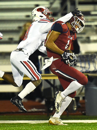 Joplin's Zach Westmoreland (1) hangs on to a pass for his first touchdown as Jefferson City's Devin White (8) defends during their district play off game on Friday night at Junge Stadium.<br /> Globe   Laurie Sisk