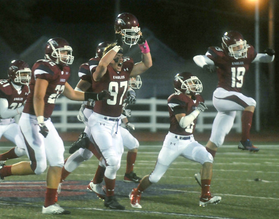 Globe/Roger Nomer<br /> The Joplin Eagles special teams unit jubilantly exits the field after recovering an onside kick during Friday's game at Junge Stadium.