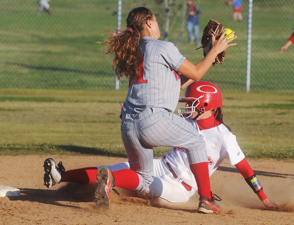Globe/Roger Nomer<br /> Ozark's Samantha Dexter slides under a tag from Webb City's Desirea Buerge during Wednesday's sectional game.