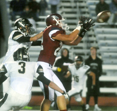 Globe/Roger Nomer<br /> Joplin's Adam St. Peter catches a pass in front of Lebanon's Austin Knight, top, and Dylan Bradshaw during Friday's game at Junge Stadium.  St. Peter ran with the catch to score a touchdown in the first quarter.