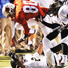 Globe/T. Rob Brown<br /> Webb City's Logan Williams nearly falls on top of Neosho's Davin Bentz as Neosho's Ryan Taylor pushes him out of bounds from behind Friday night, Oct. 5, 2012, at Webb City's field.