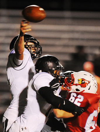 Globe/T. Rob Brown<br /> Neosho's Justin McKee throws a pass as Webb City's Casey Craig moves in close to be stopped by Neosho's Chris Goodwin Friday night, Oct. 5, 2012, at Webb City's field.