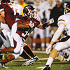 Globe/T. Rob Brown<br /> Joplin's Chris Payton-Barba winds a path between Kickapoo defenders Friday night, Oct. 19, 2012, at Junge Stadium.