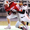 Globe/T. Rob Brown<br /> Webb City's Cooper Smith attempts to pull past West Plains' Logan Collins Thursday night, Oct. 25, 2012, during first-bracket play in the Class 4 Championship at Webb City's field.