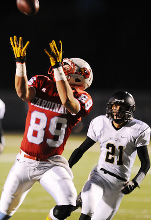 Globe/T. Rob Brown<br /> Webb City's Kohl Slaughter goes up for a pass, which he caught and carried for a big gain, as Neosho's Isaac McMaster plays defense Friday night, Oct. 5, 2012, at Webb City's field.