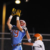 Globe/Roger Nomer<br /> Webb City's Kohl Slaughter pulls in a touchdown pass over Republic's Beau Allen during Wednesday's game.