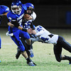 Globe/Roger Nomer<br /> Commerce's Parker Morgan escapes tackles from Colcord's Keifer Mendham (56) and Kelby Jones (24) during a run in Friday's game.