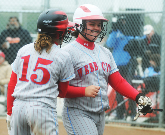 Globe/Roger Nomer<br /> Webb City's Mikaela Burgess greets Kaitlin Beason, right, as she crosses home plate to score in the third inning of Saturday's game against McDonald County.