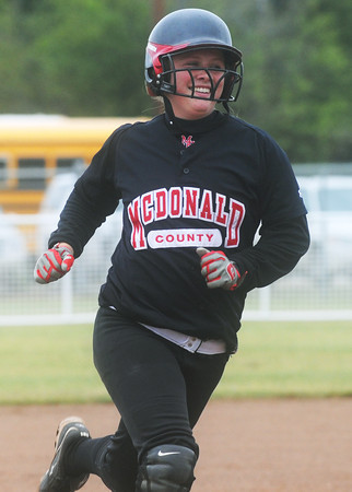 Globe/Roger Nomer<br /> McDonald County's Ashton Harmon celebrates as she runs the bases following her homerun in the third inning of Saturday's game against Webb City.
