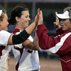 Globe/Roger Nomer<br /> Joplin Head Coach Shally Lundien double high fives Kelsey Gould, left, and Kristen Tyler after Tyler made the last out of an inning during Thursday's game.