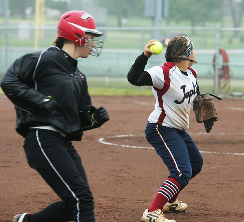 Globe/Roger Nomer<br /> McDonald County's Esmeralda Guerra takes third base as Joplin's Kelsey Gould throw to first during Friday's game.