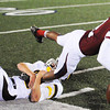 Globe/T. Rob Brown<br /> Joplin's Terrell Gilmore loses the ball as he gets brought down and pulled out of bounds by Kickapoo's Keenan Bates Friday night, Oct. 19, 2012, at Junge Stadium.