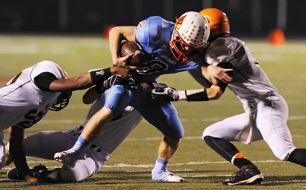 Globe/Roger Nomer<br /> Webb City's Cooper Smith fights his way through the Republic defense during Wednesday's game.