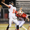 Globe/T. Rob Brown<br /> Webb City's Dalton Humphrey closes in on West Plains quarterback Jacob Mitchell Thursday night, Oct. 25, 2012, during first-bracket play in the Class 4 Championship at Webb City's field.
