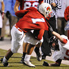 Globe/T. Rob Brown<br /> West Plains' Jacob Mitchell attempts to pull Webb City runningback Phoenix Johnson out of bounds with him Thursday night, Oct. 25, 2012, during first-bracket play in the Class 4 Championship at Webb City's field.
