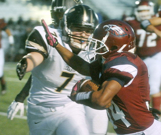 Globe/Roger Nomer<br /> Joplin's Chris Payton-Barba stiff arms Lebanon's Nick Pearcy on his way to score the Eagles' second touchdown during Friday's game at Junge Stadium.