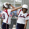 Globe/Roger Nomer<br /> Joplin's Makenzie Goswick, left, congratulates Courtney Shyrock as she comes into score the Eagles' first run of the game.