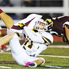Globe/T. Rob Brown<br /> Joplin's Adam St. Peter flies over Kickapoo defender Layton Harris on a carry Friday night, Oct. 19, 2012, at Junge Stadium.