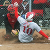 Globe/Roger Nomer<br /> Webb City's Lacy Resa slides safely into home around a tag from McDonald County's Ashton Harmon to score in the third inning of Saturday's game.