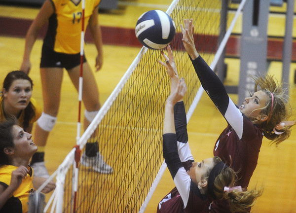 Globe/Roger Nomer<br /> Joplin's Leah Rader, left, and Jacqueline Lieurance combine for a block against Kickapoo during Tuesday's match.