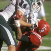 Globe/Roger Nomer<br /> Carl Junction's Matt Magee tackles Mt. Vernon's Shane Williams during Friday's game.