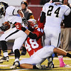 Globe/T. Rob Brown<br /> Webb City's Jose Speer brings down Neosho's Davin Bentz Friday night, Oct. 5, 2012, at Webb City's field.