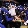 Globe/Roger Nomer<br /> (from left) Commerce's Tyson Howard, Jerrod Kirtley and Bryen Cunningham tackle Colcord's Cash Hayes during Friday's game.