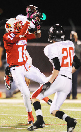 Globe/T. Rob Brown<br /> Webb City wide receiver Jalen Vaden brings down a pass ahead of West Plains' Nick Barslow (20) and another defender Thursday night, Oct. 25, 2012, during first-bracket play in the Class 4 Championship at Webb City's field.