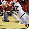 Globe/T. Rob Brown<br /> Webb City's Logan Williams gets pushed out of bounds by Neosho's Ryan Taylor Friday night, Oct. 5, 2012, at Webb City's field.
