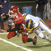 Globe/Roger Nomer<br /> Monett's Wes Abramovitz sacks Carl Junction's Dustin Satterlee for a loss during Friday's game.